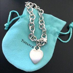 Tiffany's heart charm bracelet.